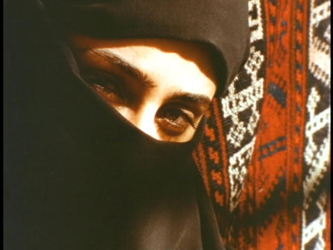 The eyes of a woman show through a black veil Footage