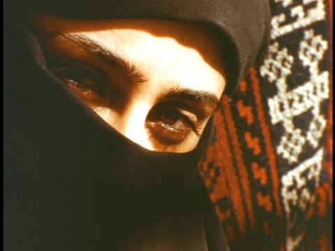 The eyes of a woman show through a black veil Stock Video Footage