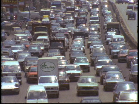 Cars drive through a traffic jam Stock Video Footage