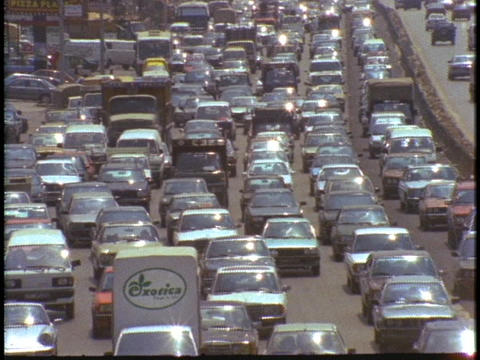 Cars drive through a traffic jam Footage