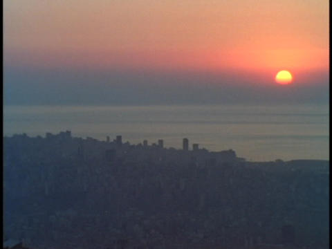 The sun sits on the horizon in Beirut Footage