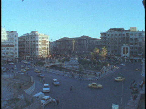 Traffic drives through Damascus, Syria Stock Video Footage