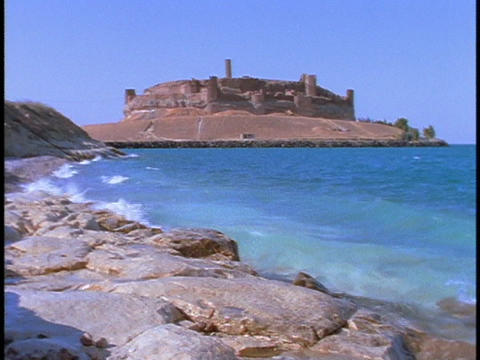 The ruins of an Arab castle stand beside the Euphrates River Stock Video Footage