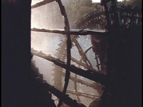 Giant waterwheels turn at a mill in Hama, Syria Stock Video Footage