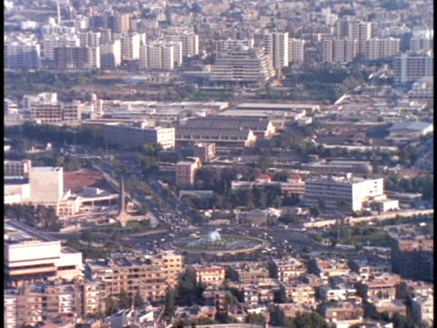 Traffic moves around a round-a-bout in Damascus, Syria Stock Video Footage