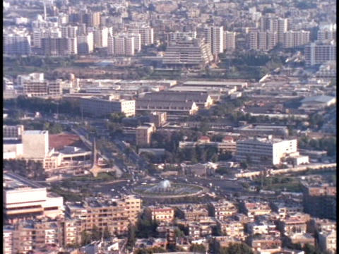 Traffic moves around a round-a-bout in Damascus, Syria Footage