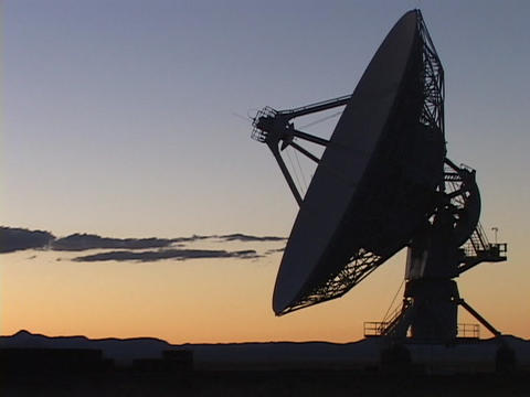 A satellite dish sits before a colorful sky in New Mexico Footage