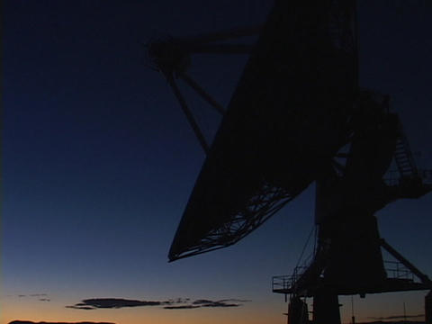A satellite dish sits before a colorful sky in New Mexico Stock Video Footage