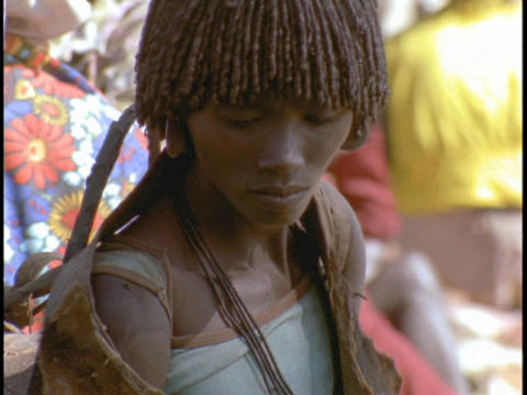 An African woman shops in an open market Stock Video Footage