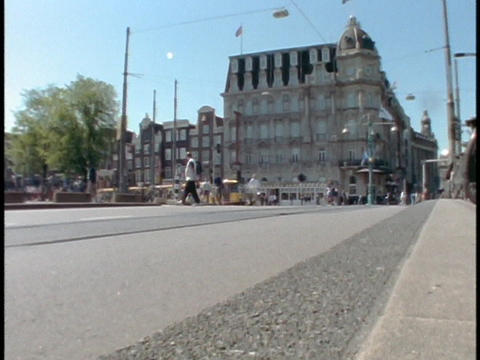 A trolley passes through Amsterdam Street in Holland Stock Video Footage