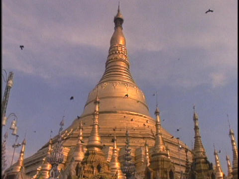 Birds fly around a Buddhist temple Stock Video Footage