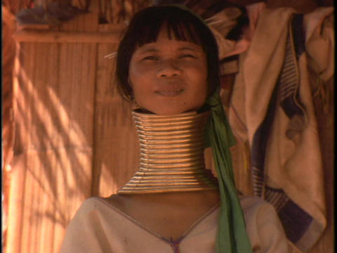 A woman of the Susan Tribe wears neck rings Stock Video Footage