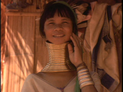 A woman of the Susan Tribe wears neck rings Footage