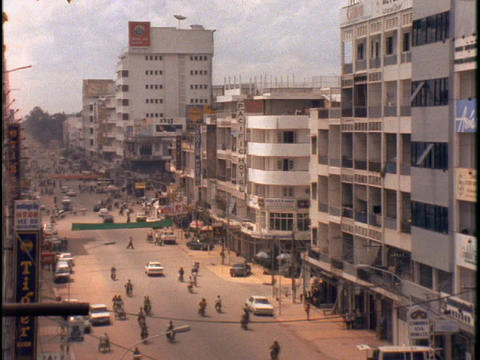 Traffic drives down a street in Phnom Penh, Cambodia Footage