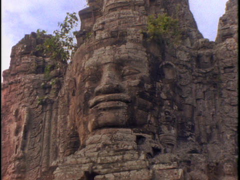 A stone face peers out of Angkor Wat Stock Video Footage