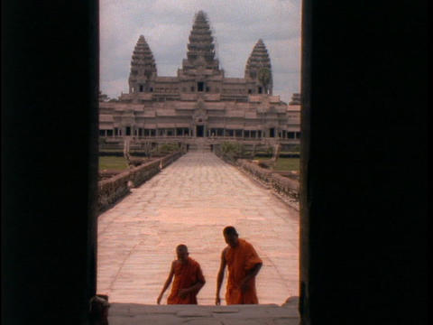 Buddhist monks walk up the stairs of Angkor Wat Stock Video Footage