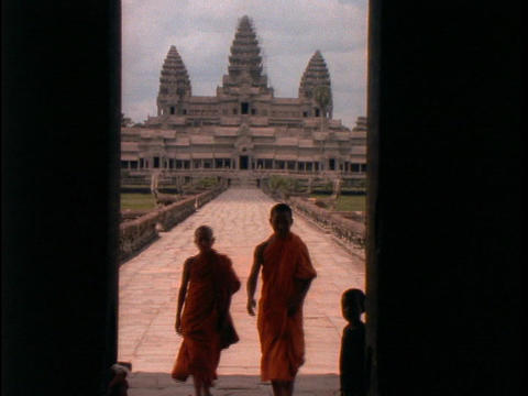 Buddhist monks walk up the stairs of Angkor Wat Footage