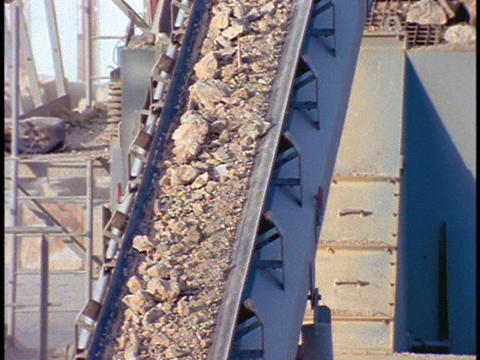 A conveyor belt moves rubble at a construction site Stock Video Footage