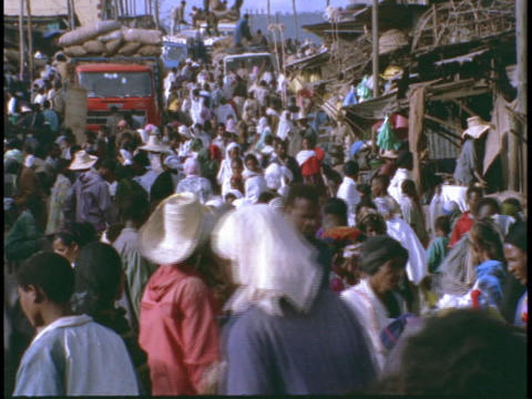 A market in Africa swarms with crowds of shoppers and vendors Footage
