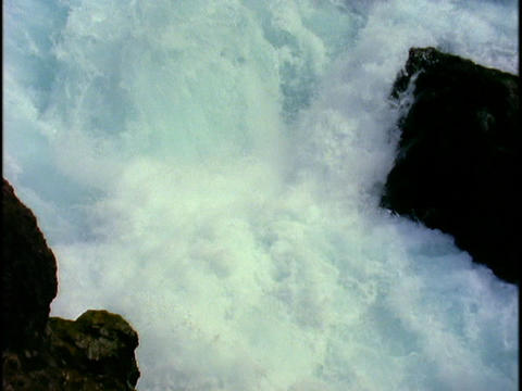 Water cascades down a water fall Stock Video Footage