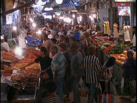 Crowds of shoppers fill the marketplace in Old City Jerusalem, Israel Footage