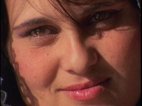An Arab woman smiles and blinks in the sunlight Stock Video Footage