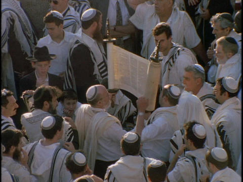 Orthodox Jews at a festival hold up Torah Stock Video Footage
