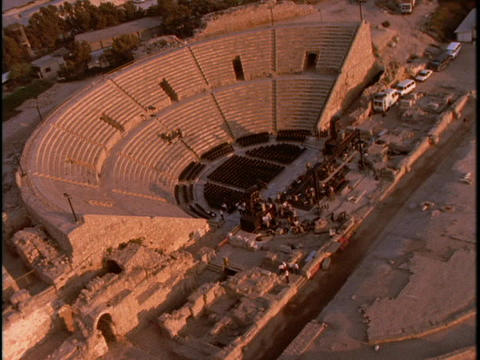 An ancient Roman Coliseum sits in the city of Caesarea Stock Video Footage