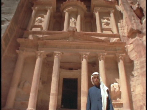 An Arab man in traditional clothing stands in front of... Stock Video Footage