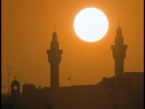 mosque towers stand out against the sunset Stock Video Footage