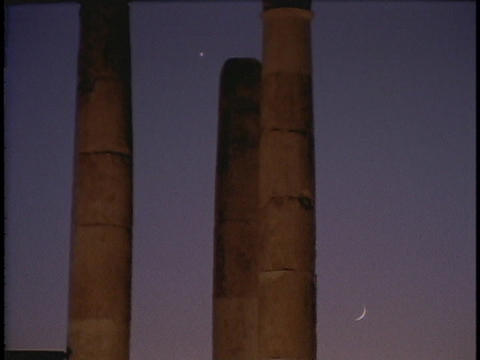 Ancient Roman pillars rise up toward the sky Stock Video Footage