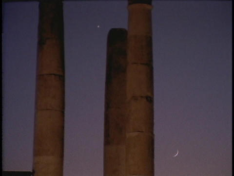 Ancient Roman pillars rise up toward the sky Footage