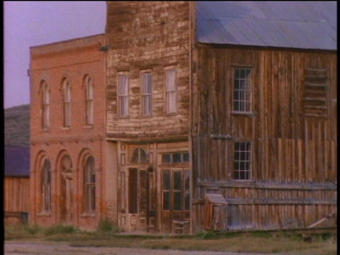 A deserted saloon stands in the ghost town of Bodie Stock Video Footage