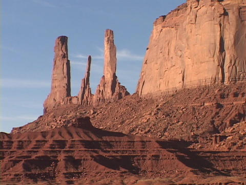 Buttes and spires rise in the desert landscape of Monument Valley, Utah Footage