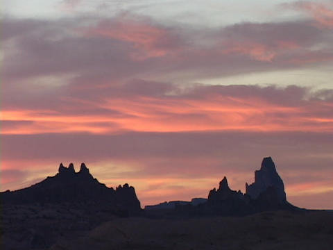 The colorful sky silhouettes rock formations in the Utah... Stock Video Footage