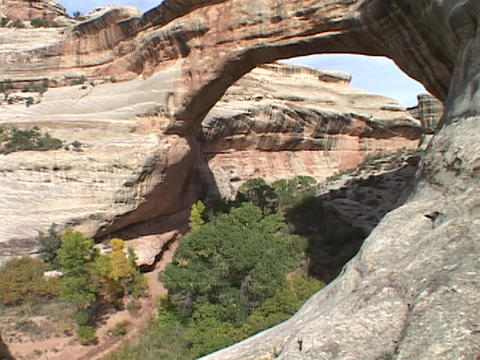 A stone arch adorns Natural Bridges National Park in Utah Stock Video Footage
