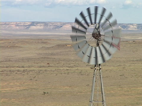 A windmill spins in the desert Live Action