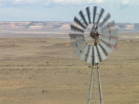 A windmill spins in the desert Stock Video Footage