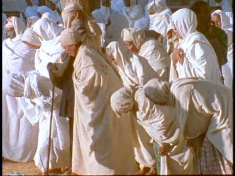 Ethiopian Coptic priests and other worshipers pray near a sacred church in Axum, Ethiopia Footage