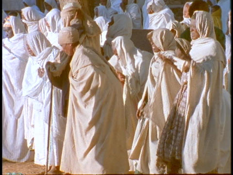 Ethiopian Coptic priests and other worshipers pray near a... Stock Video Footage