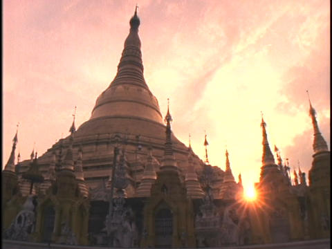 Spires of the Shwedagon Buddhist Pagoda rise into a pink... Stock Video Footage