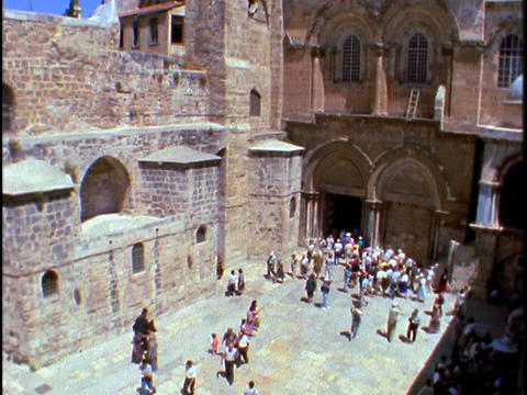 Pilgrims visit the Church of the Holy Sepulchre in Jerusalem Stock Video Footage