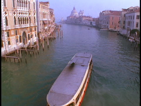 A riverboat floats down the Venice canals Stock Video Footage