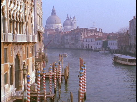 A ferryboat crosses a canal in Venice Stock Video Footage