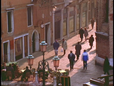 Pedestrians walk along a lane in Venice Stock Video Footage