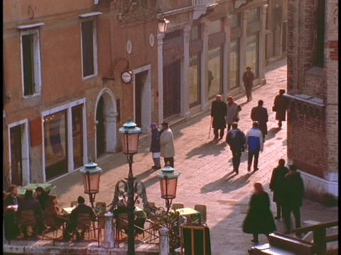 Pedestrians walk along a lane in Venice Footage