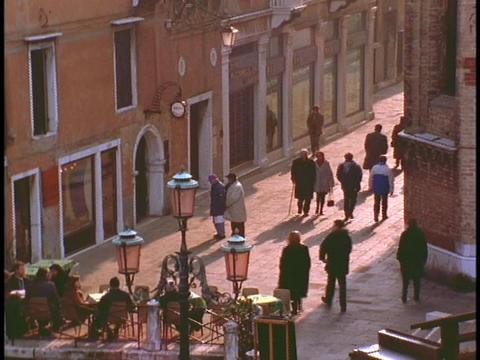 Pedestrians walk along a lane in Venice Stock Video Footage