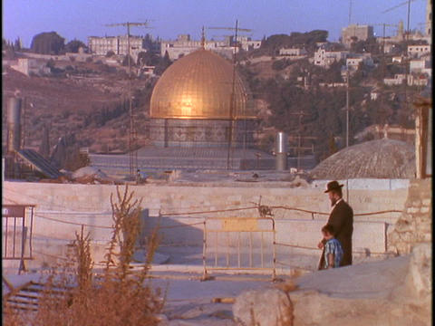 A Jewish man and his son walk past the Dome of the Rock... Stock Video Footage