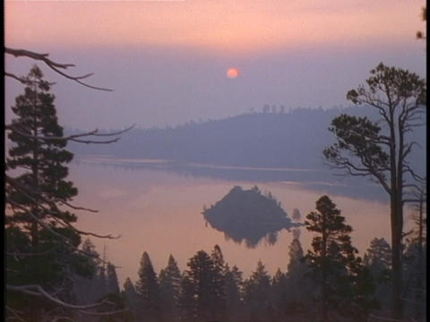 A forest surrounds Emerald Bay at Lake Tahoe Stock Video Footage