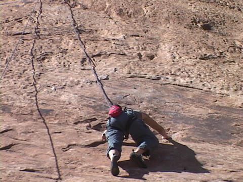 A rock climber scales a wall Stock Video Footage